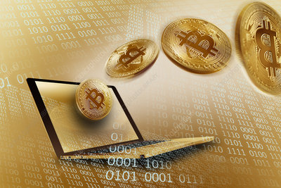Golden Bitcoins over laptop