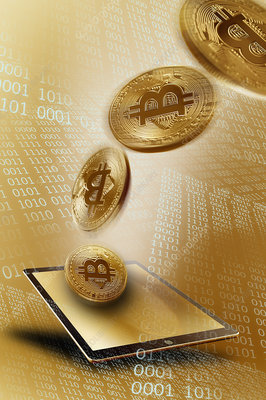 Golden Bitcoins over digital tablet