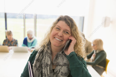 Smiling businesswoman talking on smart phone
