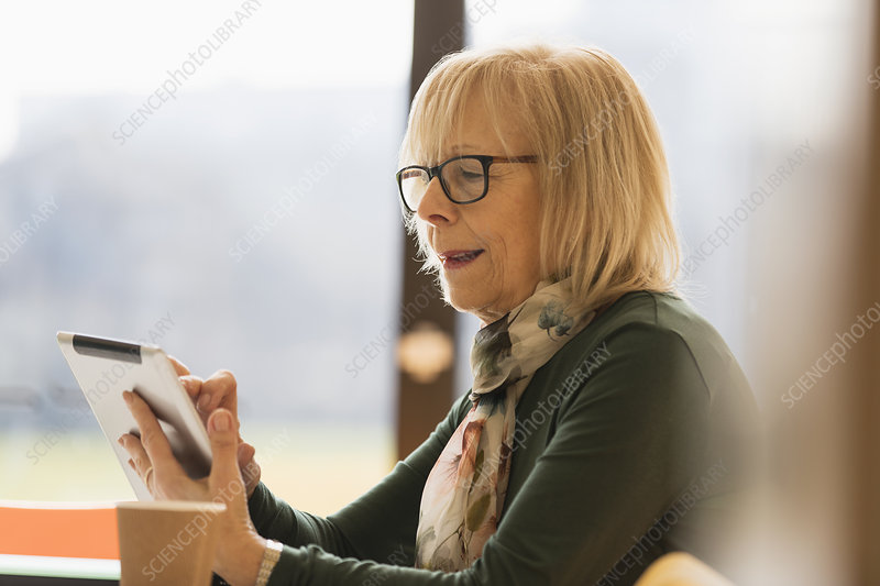 Senior businesswoman using digital tablet