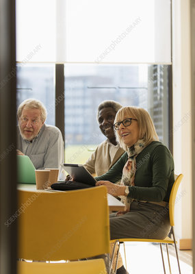 Smiling business people in conference room meeting