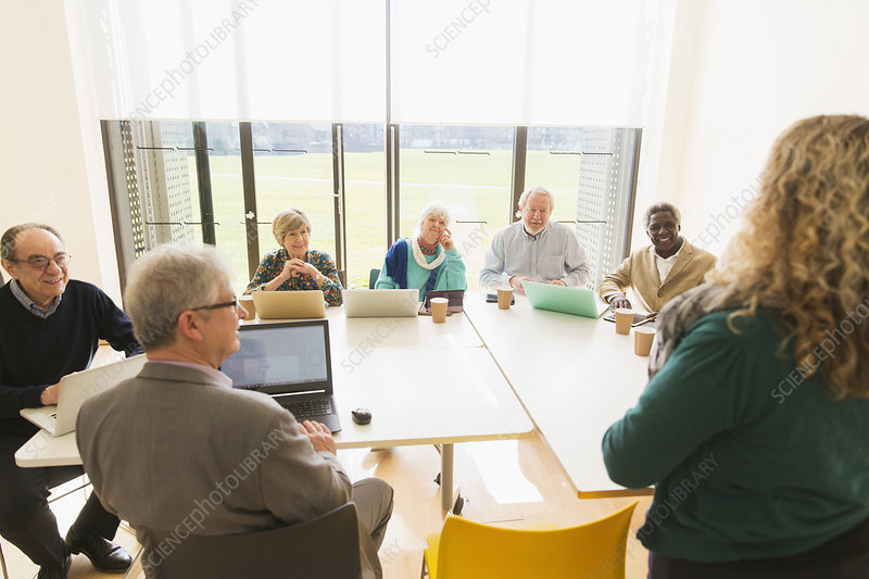 Senior business people using digital tablets and laptops