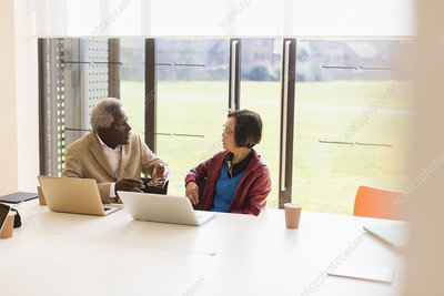 Senior business people talking in conference room meeting