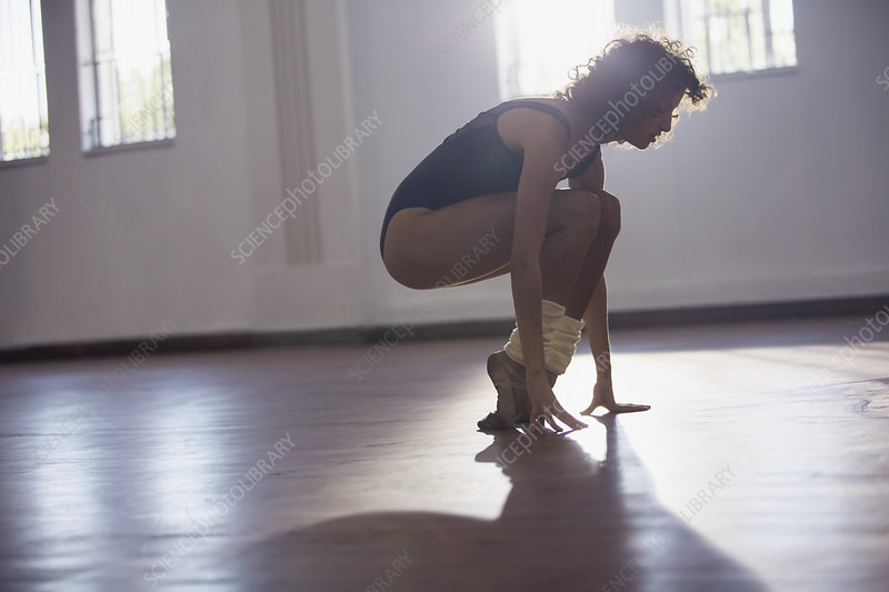 Strong young female dancer stretching toes