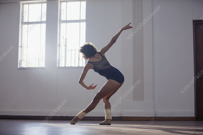 Graceful young female dancer practicing