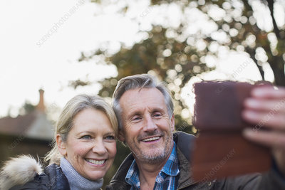 Mature couple taking selfie