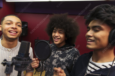 Teenage musicians recording music