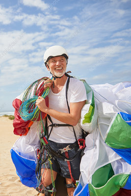 Smiling mature male paraglider