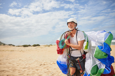 Smiling male paraglider