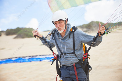 Focused mature male paraglider