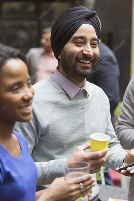 Smiling man in turban enjoying party