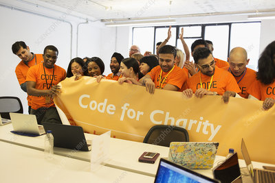 Hackers with banner coding at hackathon