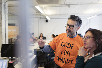 Hackers planning, coding for charity at hackathon