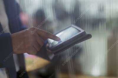 Close up businessman using digital tablet