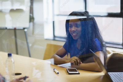 Smiling young businesswoman with smart phone