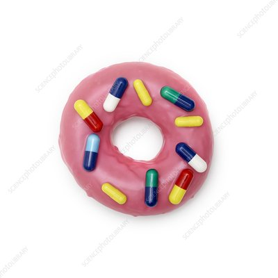 Pink doughnut with capsules