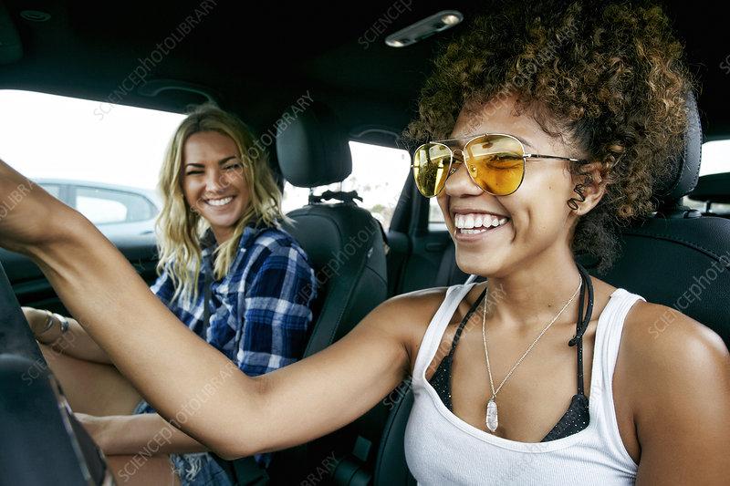 Happy women in car