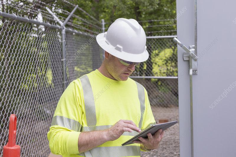 Engineer using digital tablet