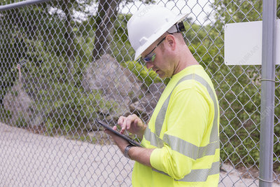 Engineer using digital tablet