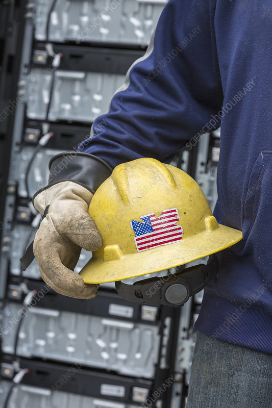 Engineer carrying hard hat with US flag