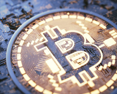 Bitcoin logo on circuit board, illustration
