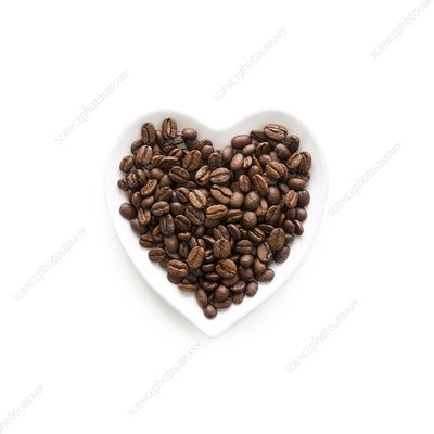 Coffee beans in heart shape bowl