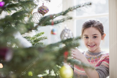 Portrait girl decorating Christmas tree