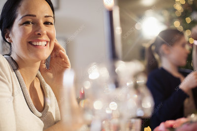 Portrait smiling woman enjoying Christmas dinner