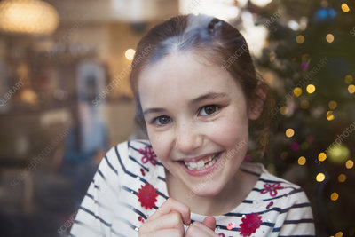 Portrait smiling girl in Christmas living room
