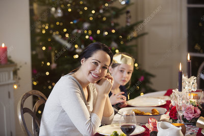 Mother and daughter enjoying Christmas dinner
