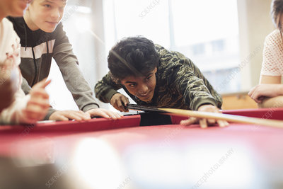 Teenagers playing pool