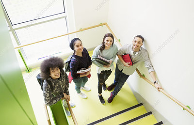 Portrait high school students on stair landing