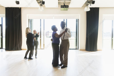 Active seniors dancing in dance class