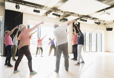 Active seniors dancing, exercising and stretching