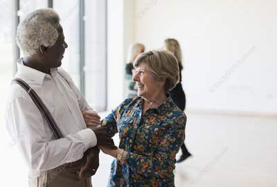 Active senior couple dancing in dance class