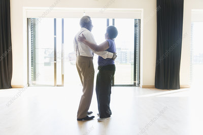 Active senior couple dancing