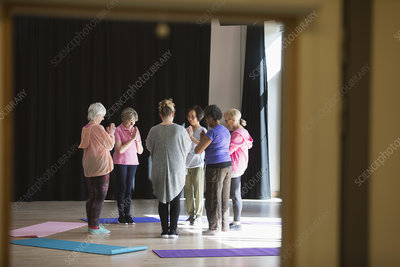 Serene active seniors practicing yoga in circle