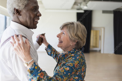 Happy active senior couple dancing