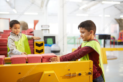 Boy playing at interactive construction exhibit