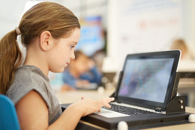 Girl playing game on laptop