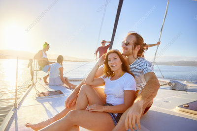 Couple relaxing on sunny boat