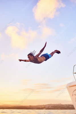 Young man diving into ocean