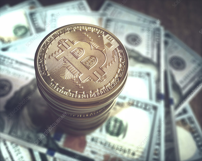 Bitcoin and one hundred US dollar notes, illustration - Stock Image