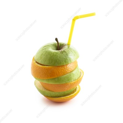 Sliced apple and orange with drinking straw