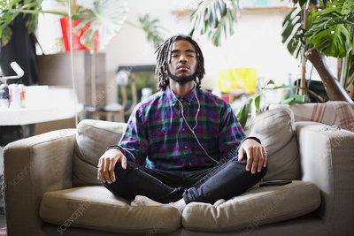Serene young man meditating