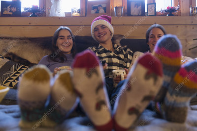 Family in colourful socks relaxing