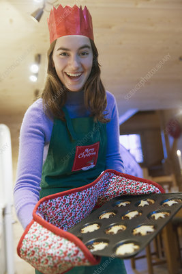 Portrait enthusiastic girl baking muffins