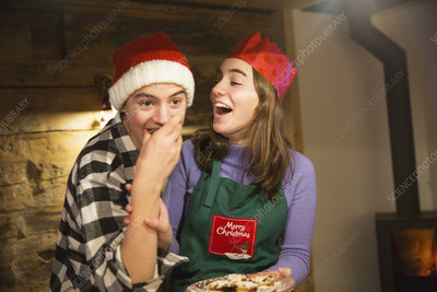Brother and sister eating Christmas cookies