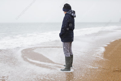 Teenage boy in rubber boots