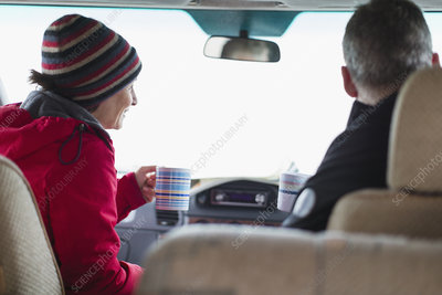 Couple drinking coffee in motor home